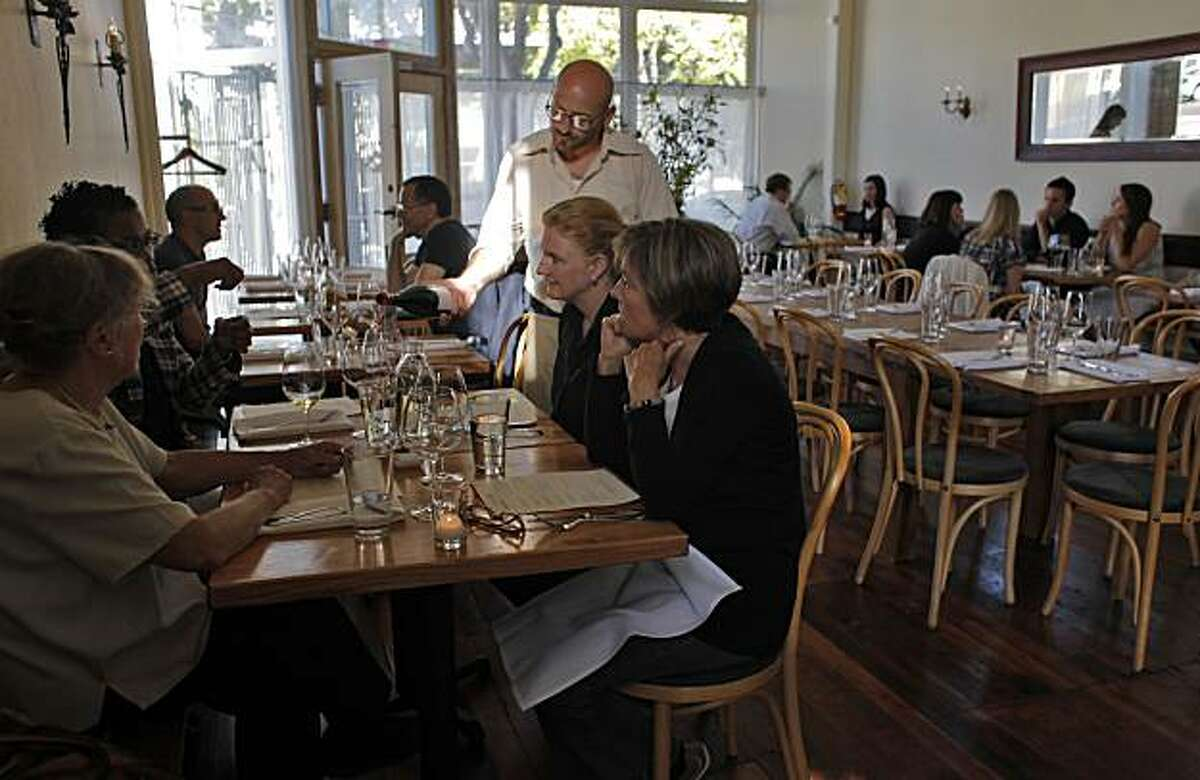People enjoy dinner with wine at the newly opened Heirloom Restaurant, Tuesday June 29, 2010, in San Francisco, Calif.
