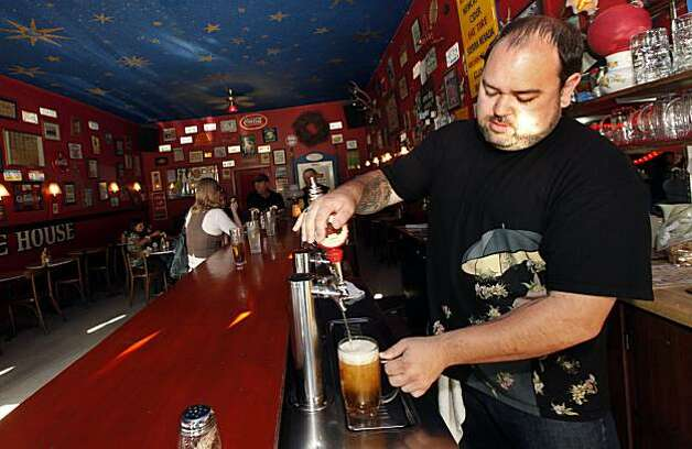 Bartender Richard Pazderka pours a pint of European beer. Frankie's Bohemian Cafe features both domestic and European draft beers as well as a wide menu that included a Bohemian burger with garlic fries and mushrooms, or a sausage and meatball brambory Thursday July 1, 2010.   Ran on: 07-08-2010 Photo caption Dummy text goes here. Dummy text goes here. Dummy text goes here. Dummy text goes here. Dummy text goes here. Dummy text goes here. Dummy text goes here. Dummy text goes here. Photo: Lance Iversen, The Chronicle