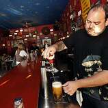 Bartender Richard Pazderka pours a pint of European beer. Frankie's Bohemian Cafe features both domestic and European draft beers as well as a wide menu that included a Bohemian burger with garlic fries and mushrooms, or a sausage and meatball brambory Thursday July 1, 2010.   Ran on: 07-08-2010 Photo caption Dummy text goes here. Dummy text goes here. Dummy text goes here. Dummy text goes here. Dummy text goes here. Dummy text goes here. Dummy text goes here. Dummy text goes here.