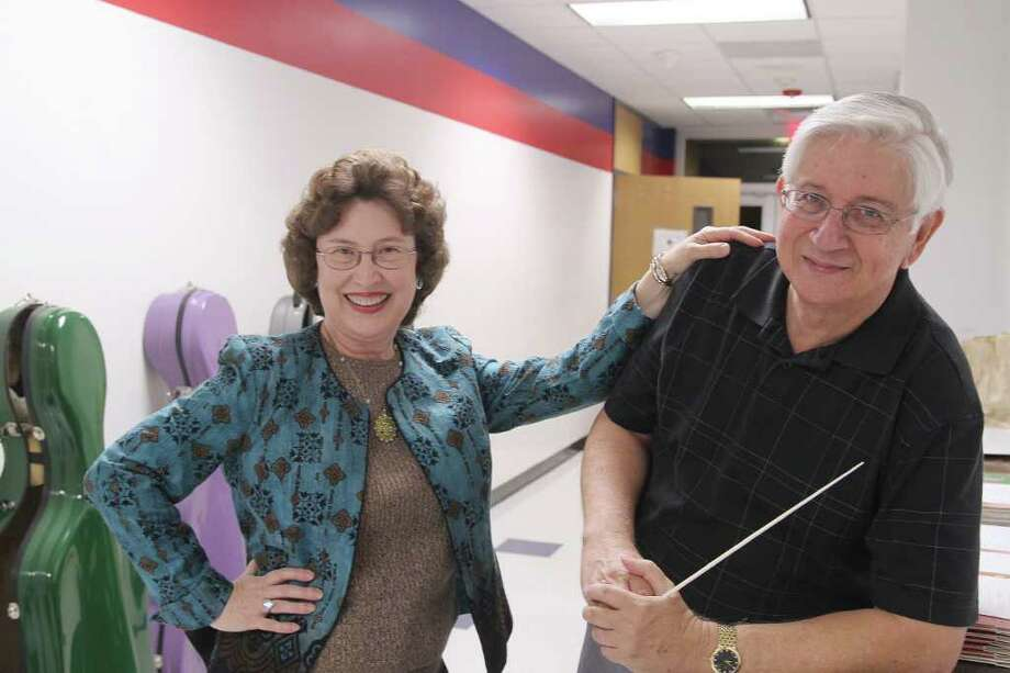 MUSIC LOVERS: Betty Wall, general manager of the Clear Lake Symphony Orchestra, and her husband Robert F. Wall, associate conductor, said the orchestra's  Christmas Pops concert is always a crowd pleaser. Photo: Pin Lim / Copyright Pin Lim.