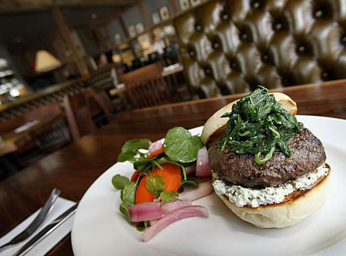 The lamb burger is a popular choice by patrons at Norman Rose Tavern. Norman Rose Tavern in downtown Napa, Calif. is a large restaurant with several bars, including one with large flat-screen televisions.