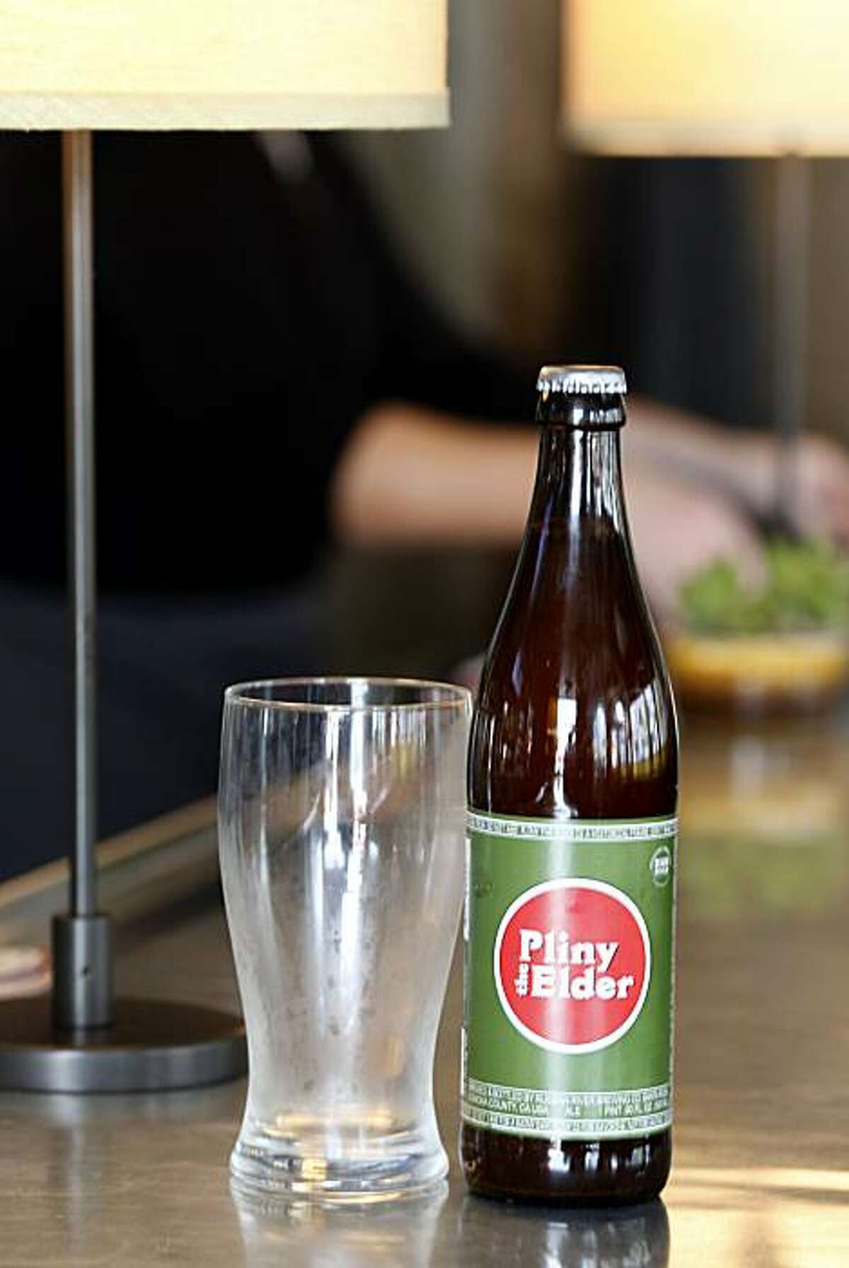 A large assortment of bottled beers including Pliny the Elder from the Russian River Brewing Company is available at Norman Rose Tavern. Norman Rose Tavern in downtown Napa, Calif. is a large restaurant with several bars, including one with large flat-screen televisions.