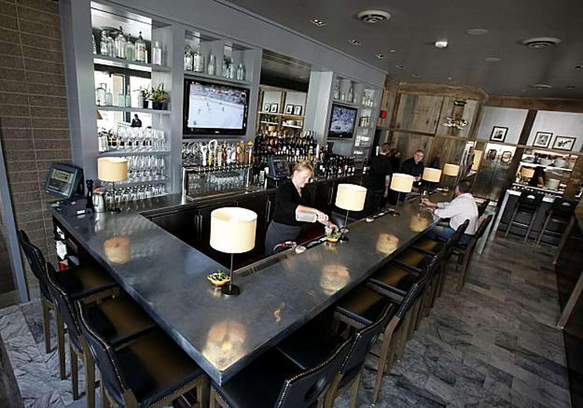 The main bar at Norman Rose Tavern usually has sporting events on the tube. Norman Rose Tavern in downtown Napa, Calif. is a large restaurant with several bars, including one with large flat-screen televisions.