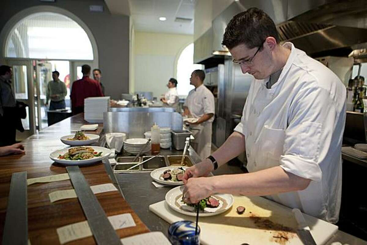 Chef Matthew Silverman plates at the open kitchen at Laurus Bistro in the Blackhawk Plaza Shopping Mall in Danville, Calif. on Thursday, May 27, 2010. Kat Wade / Special to the Chronicle