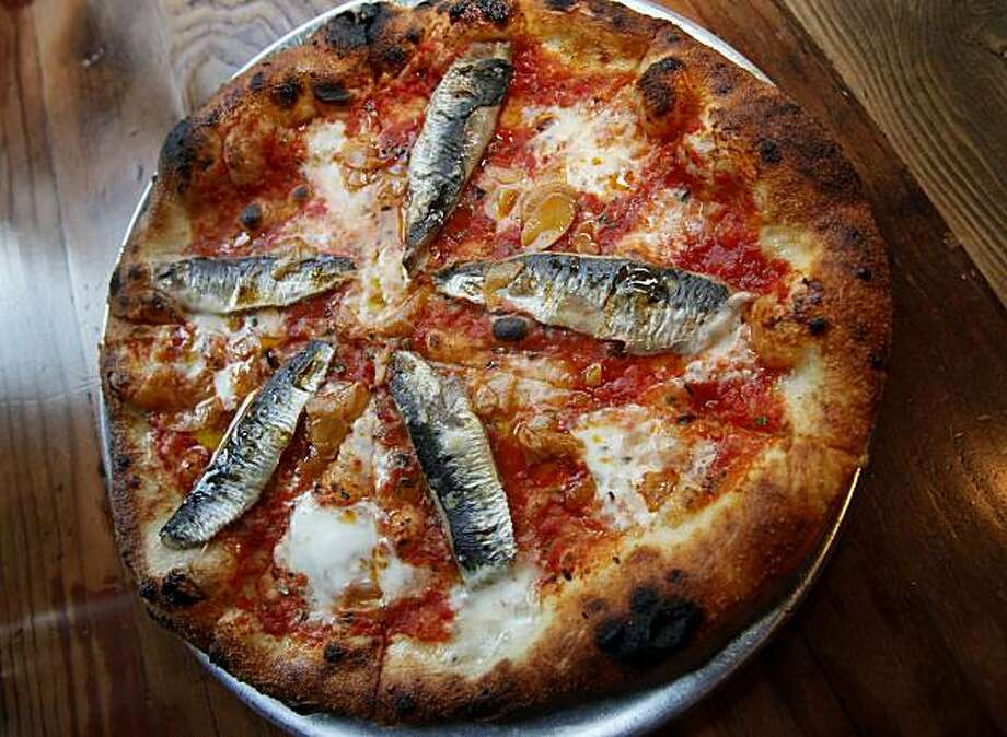 The Monterey Bay Sardine pizza is a favorite on the menu Wednesday May 26, 2010. Oenotri is a popular restaurant in downtown Napa, Calif. which features a large dining room with a view of the expansive kitchen. Photo: Brant Ward, The Chronicle