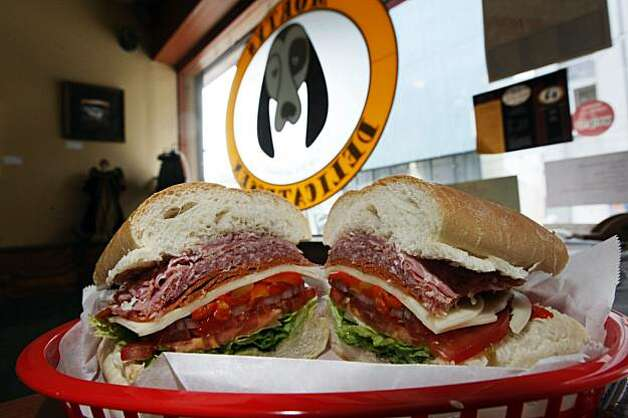 Morty's Deli at 280 Golden Gate Avenue in San Francisco is a great sandwich shop, where diners can either eat in or take to go, offering a Little Italy on a French bread roll. Tuesday May 18, 2010   Ran on: 05-27-2010 Morty's Deli on Golden Gate Avenue, right, offers a variety of sandwiches, including the Little Italy, above  --  a sourdough roll stuffed with Genoa salami, coppicola, pepperoni and provolone. The small Tenderloin shop also offers a variety of hot sandwiches, vegetarian selections and salads. Photo: Lance Iversen, The Chronicle