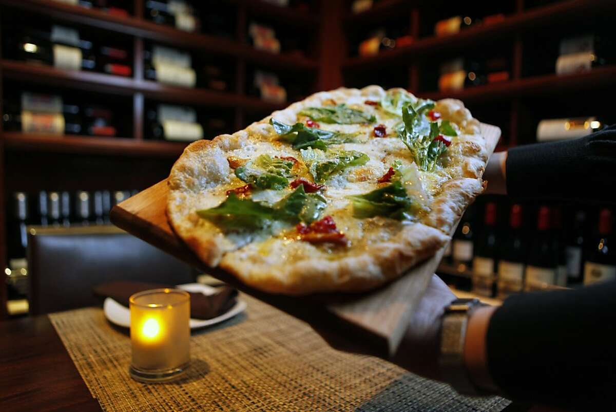 Ristobar a new restaurant in the Marina district at 2300 Chestnut (at Scott) in San Francisco offers a wide Italian menu that includes pizza, named Market Street, smoked mozzarella, escarole, calabrian chili with herbs. Wednesday April 21, 2010
