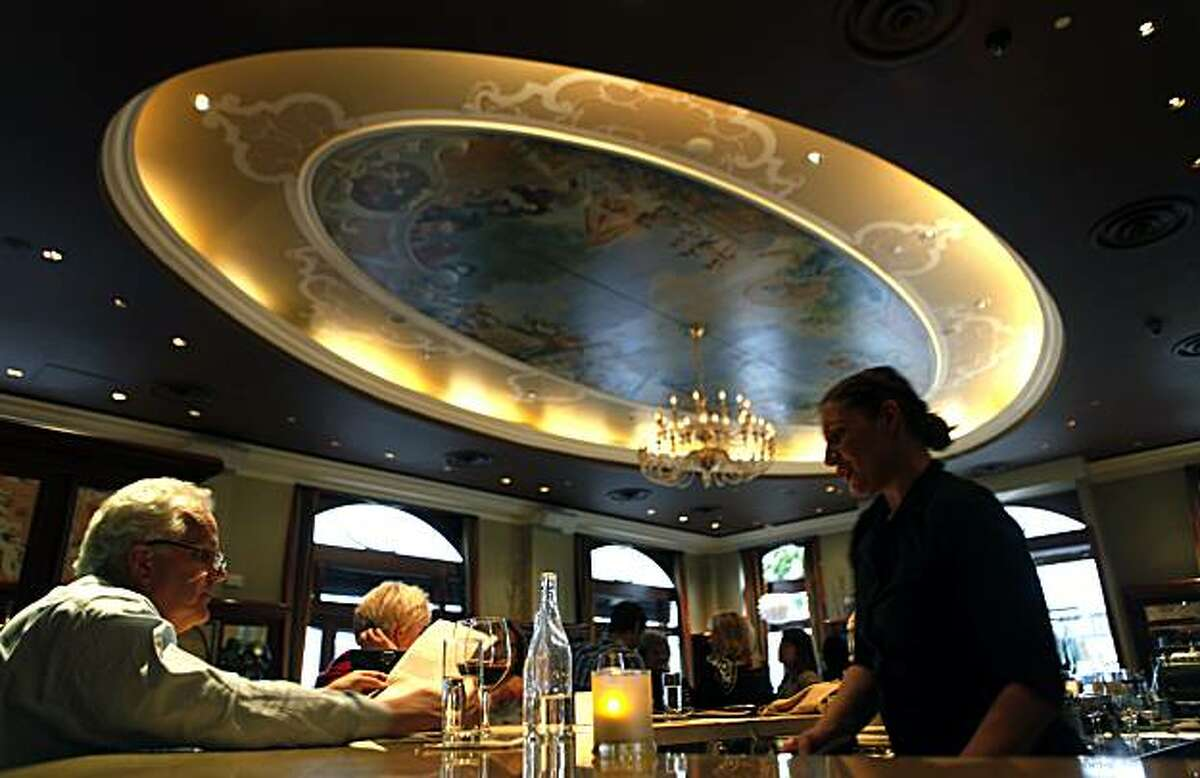 Celena Estrada a Wine Tender right, waits on Steven Kinney at Ristobar a new restaurant in the Marina district at 2300 Chestnut (at Scott) in San Francisco that offers a wide Italian menu. Wednesday April 21, 2010