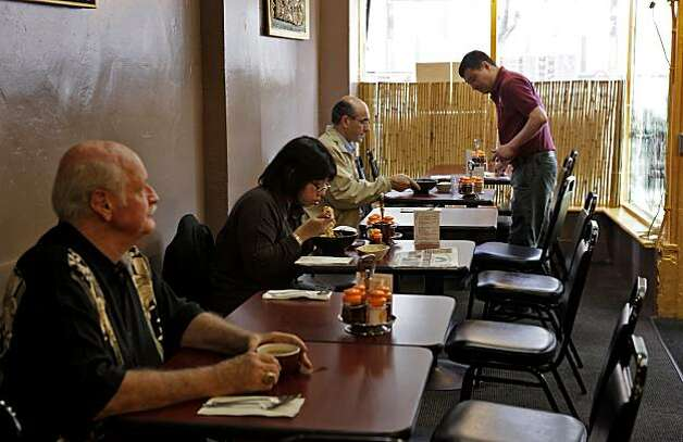 People enjoy their lunch at the Burmese Kitchen, Wednesday April 28, 2010, in San Francisco, Calif. What once was a deli type restaurant  is now a sit down place only serving burmese food. Photo: Lacy Atkins, The Chronicle