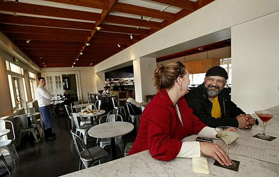 Stacey Griffin (left) and Shahin Khosravi enjoy a cocktail at the bar at The El Dorado Kitchen. The El Dorado Kitchen in Sonoma, Calif.  has a bar setting just off the main dining room which also features a patio area. Photo: Brant Ward, The Chronicle