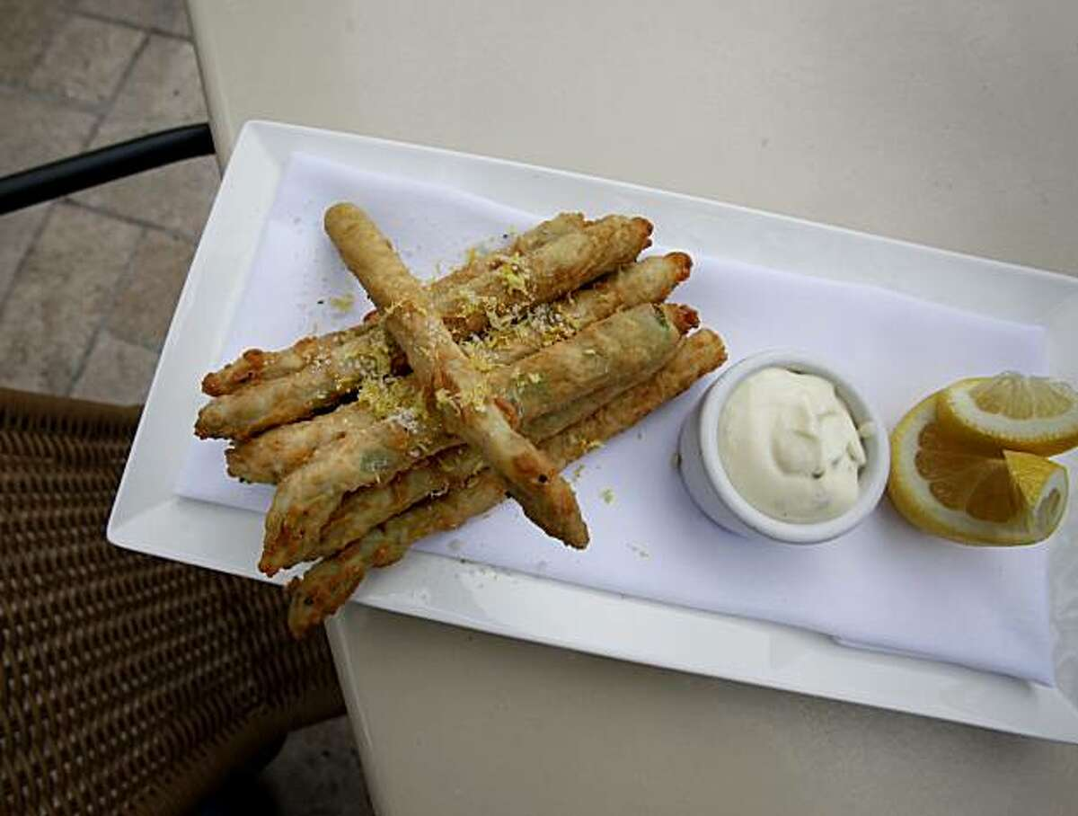 The farm frites features crispy delta asparagus. The El Dorado Kitchen in Sonoma, Calif. has a bar setting just off the main dining room which also features a patio area.