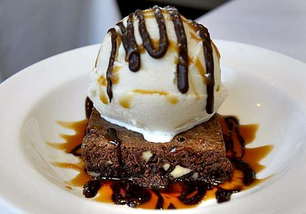 The brownie with ice cream is a popular dessert at the cafe. The Balboa Cafe, the original is on Fillmore Street in San Francisco, is just a block from the main downtown area of Mill Valley and also has outdoor seating. Photo: Brant Ward, The Chronicle
