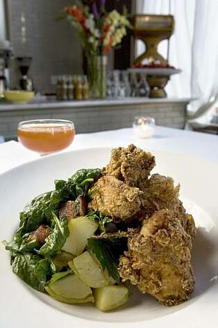 Miss Ollies Fried Chicken with sweet Boniato puree, haricot  verts, baby carrots, curly kale, giblet gravy served with a Calypso Cocktail; Gosling Black Seal Rum, Falernum, lemon, pineapple syrup at Hibiscus restaurant in Oakland on Friday, April 30, 2010.  The new Hibiscus, Carribean creole cuisine restaurant is a vision from Chef Sarah Kirnon, former chef at the popular Front Porch in San Francisco. Kat Wade / Special to the Chronicle Photo: Kat Wade, Special To The Chronicle