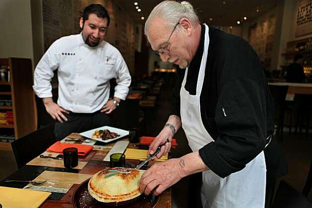 Chef Gustavo Romero Veytia (left) watches as executive chef Mario Luigi Maggi cuts open a sedanini alla credo at Credo, an Italian restaurant on Pine St. in San Francisco, Ca., on March 17, 2010. Photo: Liz Hafalia, The Chronicle