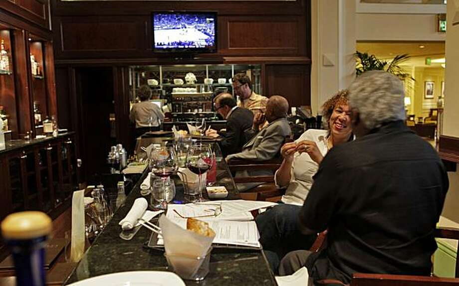 People enjoy themselves at the bar, Thursday April 23, 2010, at the Meritage Restaurant in the Claremont Resort in Berkeley, Calif. Photo: Lacy Atkins, The Chronicle