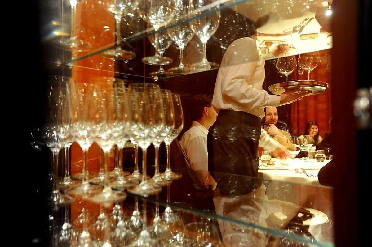 A waiter serves wine at Baume on Thursday, April 15, 2010, in Palo Alto, Calif.