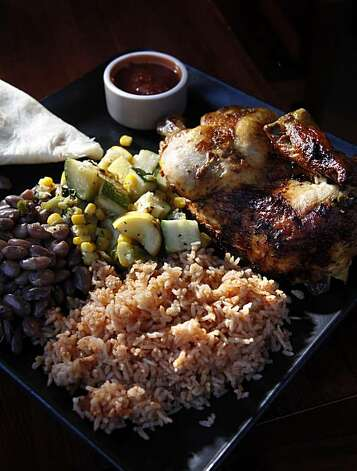 The rotisserie chicken plate served with calabacitas and served at Green Chile Kitchen restaurant, a New Mexican restaurant in the Nopa area of San Francisco, Calif., seen here on Tuesday, March 31, 2010. Photo: Carlos Avila Gonzalez, The Chronicle