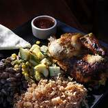 The rotisserie chicken plate served with calabacitas and served at Green Chile Kitchen restaurant, a New Mexican restaurant in the Nopa area of San Francisco, Calif., seen here on Tuesday, March 31, 2010.
