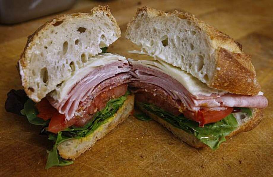 An Italian combo sandwich is ready for takeout at Lucca Delicatessen on Chestnut Street in San Francisco, Calif., on Friday, April 2, 2010. Photo: Paul Chinn, The Chronicle