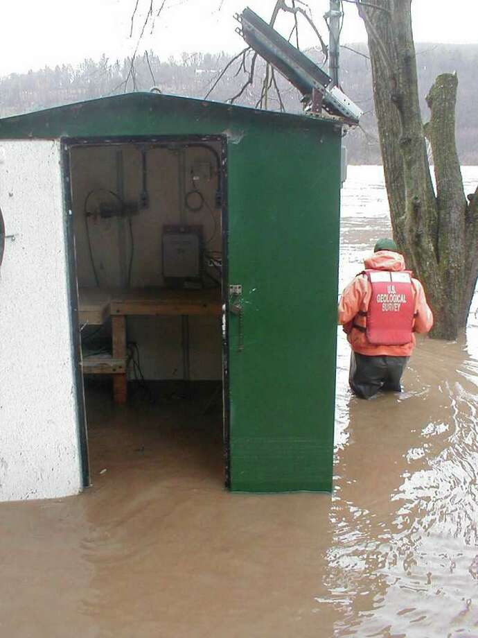 Flood waters on the Delaware River in Callicoon, Sullivan County, inundate a federally-operated river gauge in April 2005. Budget troubles at the U.S. Geological Survey could result in more than 30 such gauges being turned off this spring.