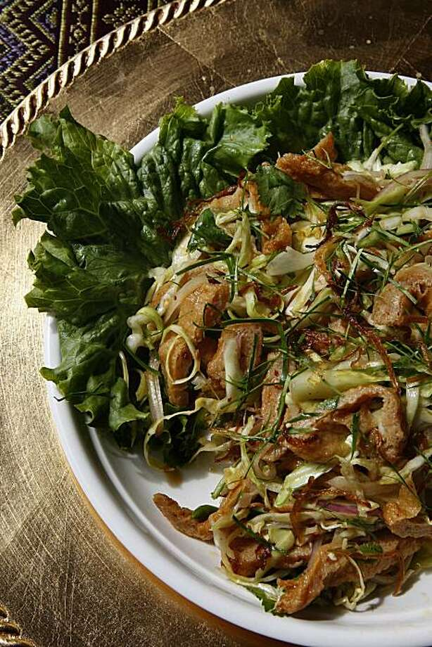 Fish cake salad--salad prepared with burmese style spiced fish cake, shredded cabbage, onion, crispy garlic chips, cilantro with lime dressing--at Little Yangon on the top of the hill Daly City, Calif., on Wednesday, March 24, 2010. Photo: Liz Hafalia, The Chronicle
