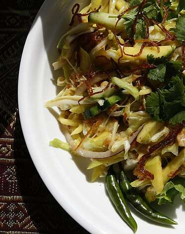 Mango salad--sweet and sour mango slices, shredded cucumber, onion, garlic chips, dried grounded shrimp (or vegetarian), roasted red pepper flake, cilantro and house special dressing--at Little Yangon on the top of the hill Daly City, Calif., on Wednesday, March 24, 2010. Photo: Liz Hafalia, The Chronicle