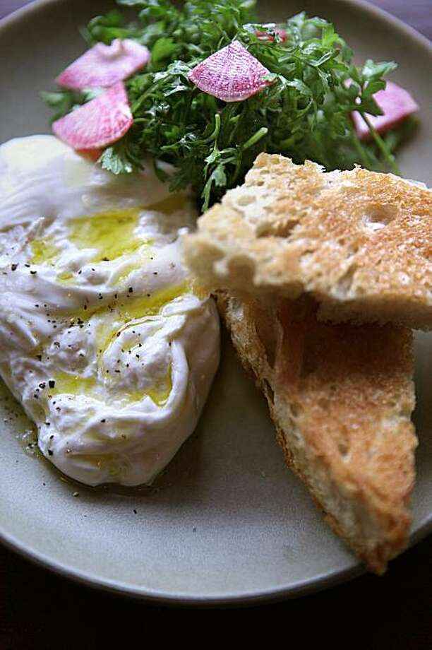 Burrata with curly cress and watermelon radish salad,  at Boot and Shoe Service Pizzeria on 3308 Grand Ave. in Oakland, Ca., on Thursday, February 19, 2010. Photo: Liz Hafalia, The Chronicle