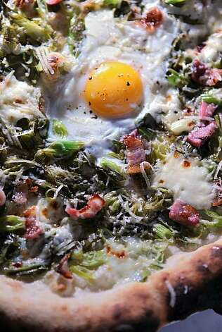 Wood oven pizza with green onion, sausage and an egg, at Boot and Shoe Service Pizzeria on 3308 Grand Ave. in Oakland, Ca., on Thursday, February 19, 2010. Photo: Liz Hafalia, The Chronicle