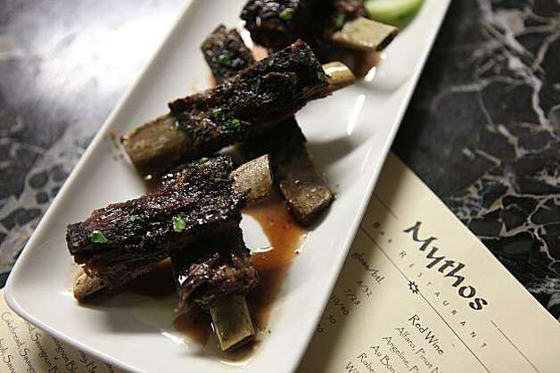 Arnisia Plevrakia--grilled lamb riblets with pomogranate sauce-- at Mythos bar and restaurant in San Carlos, Ca.,  on Thursday, February 12, 2010. Photo: Liz Hafalia, The Chronicle
