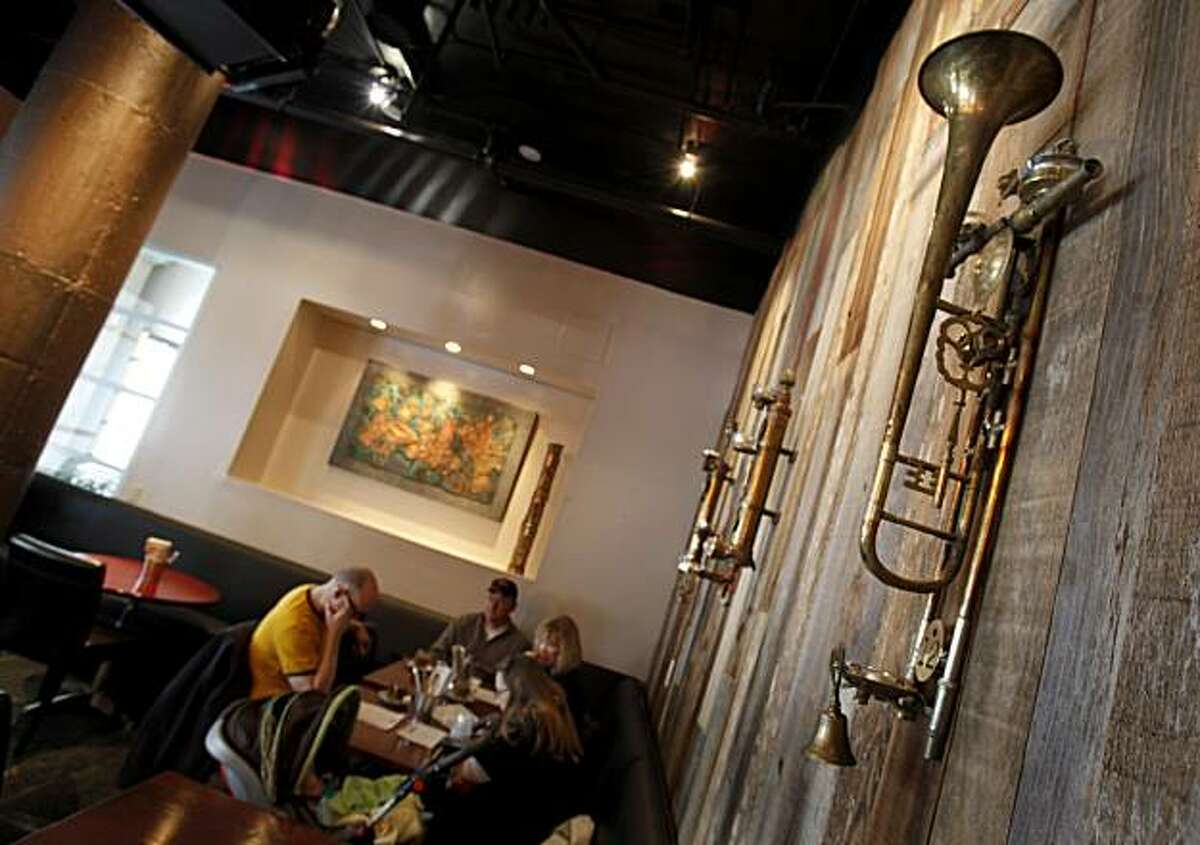 Musical instrument sculptures adorn the walls of the eatery. The Chop Bar in Oakland features a large airy dining area with a rounded bar near the kitchen.Musical instrument sculptures adorn the walls of the eatery. The Chop Bar in Oakland features a large airy dining area with a rounded bar near the kitchen.