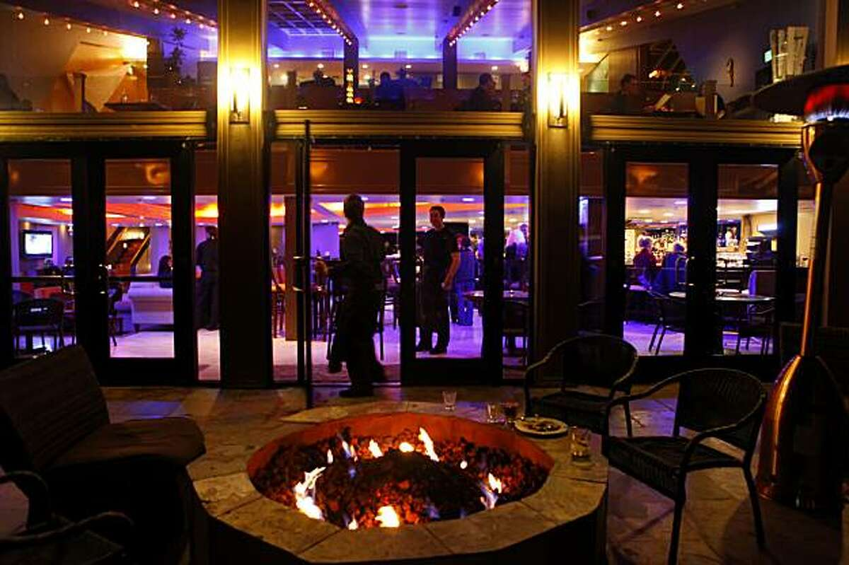 People enjoy the fire pit outside, Wednesday Dec. 30, 2009, at the La Costanera restaurant in Montara, Calif.