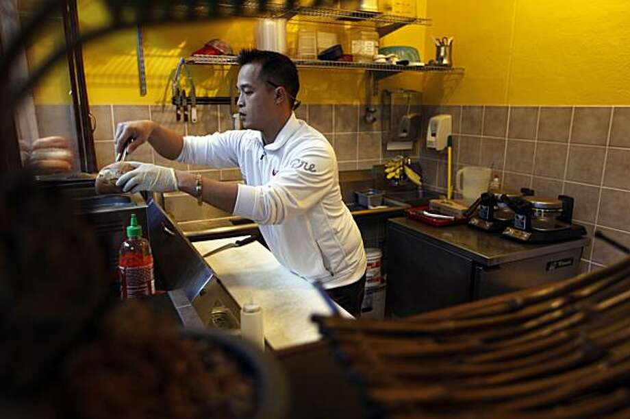 Eddie Nguyen, is the co-owner of the Saigon Deli Express, located at Embarcadero 4, in San Francisco,Ca.  on Wednesday December 23, 2009. Photo: Michael Macor, The Chronicle
