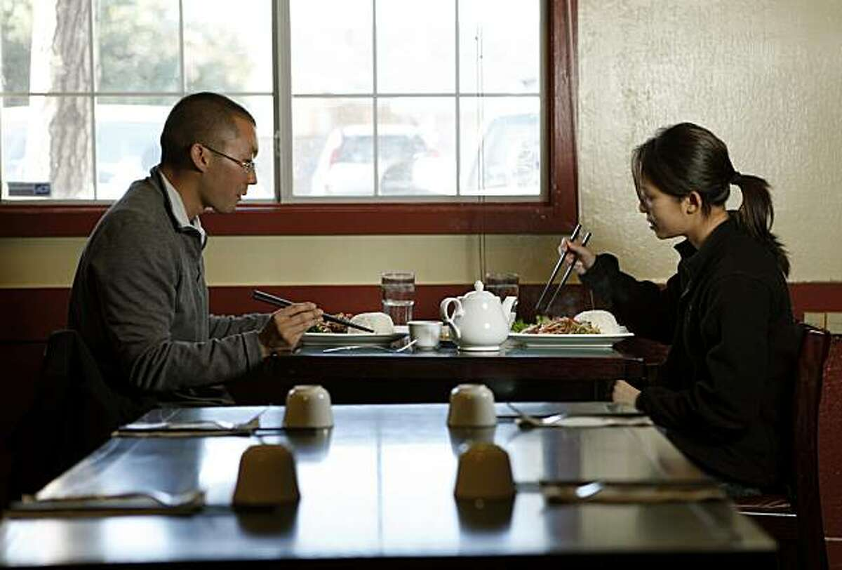 Keith Kobata and Serena Yau both from Concord injoy Beijing Duck at Sichuan Fortune House in Pleasant Hill Tuesday November 24, 2009.