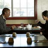 Keith Kobata and Serena Yau both from Concord injoy Beijing Duck at Sichuan Fortune House in Pleasant Hill.