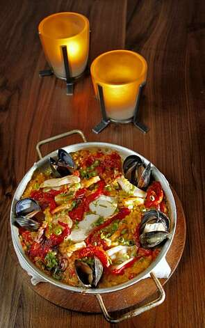 People enjoy one of Ironside Restaurants specialties is a seafood paella, Tuesday Nov. 17, 2009,  in San Francisco, Calif. Photo: Lacy Atkins, The Chronicle