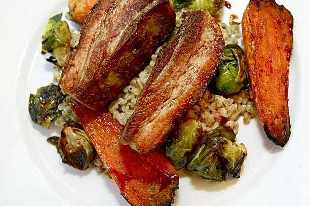 The roast of the day is pork belly with farro. Gialina serves one of the finest pizzas in the Bay Area from their unassuming location on Diamond Street near the Glen Park BART station. Photo: Brant Ward, The Chronicle