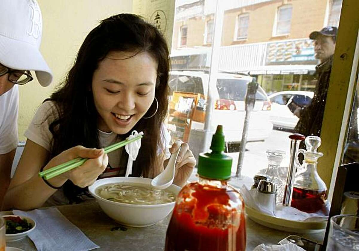 Won Seo having chicken noodle soup at Turtle Tower, 631 Larkin St, between Eddy and Ellis in the Tenderloin in San Francisco, Calif., on Monday, November 2, 2009.