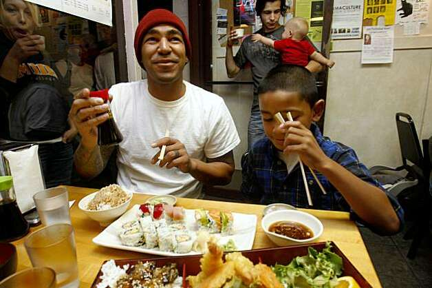 John Palega (left) and his son Jalen Palega, 8 years old, from Richmond, having a lobster roll, salmon roll, tuna roll, and tempura roll at Geta restaurant, a Japanese restaurant in Oakland, Calif., on Thursday, October 15, 2009.  They've frequented Geta for 2 years. Photo: Liz Hafalia, The Chronicle