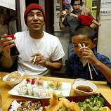 John Palega (left) and his son Jalen Palega, 8 years old, from Richmond, having a lobster roll, salmon roll, tuna roll, and tempura roll at Geta restaurant, a Japanese restaurant in Oakland, Calif., on Thursday, October 15, 2009.  They've frequented Geta for 2 years.