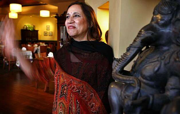 Neela Paniz owner of Neela's Indian Restaurant waves to customers, Tuesday Sept. 29, 2009, in Napa, Calif. Photo: Lacy Atkins, The Chronicle