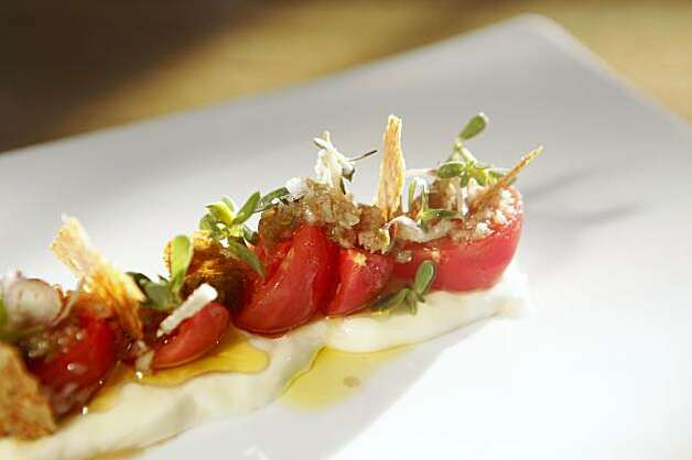 Early Girl Tomatoes, pickled shallots and fresh cow's milk cheese with wheat bran is served at Commis on Piedmont Avenue on Friday Sep. 11, 2009 in Oakland, Calif. Photo: Mike Kepka, The Chronicle