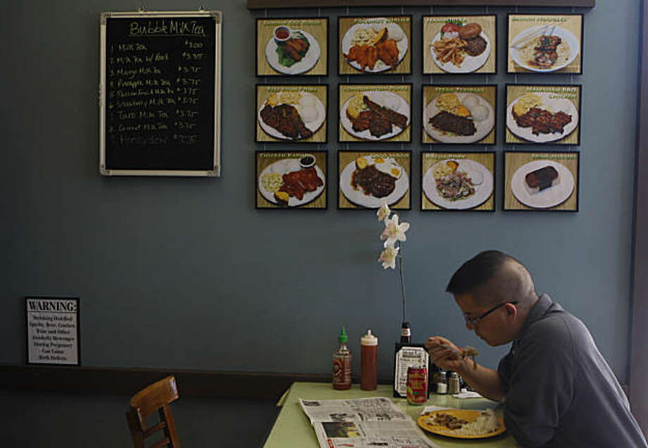 Hilton Woo of San Francisco enjoys a meal at Mauna Loa Hawaiian BBQ in San Rafael, Calif. on Tuesday, September 1, 2009. Photo: Lea Suzuki, The Chronicle