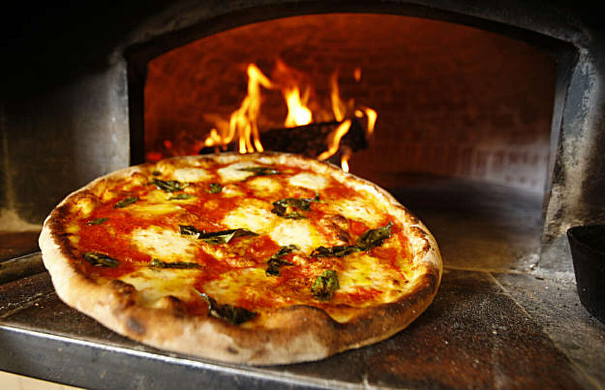 Tony Gemignani garnered national headlines a few years ago when he beat the Italians at pizza making, in the 2007 World Pizza Cup in Naples Italy with this creation called Margherita. He's now opened a restaurant in San Francisco's North Beach where he has four ovens and does four distinct styles of pizza.