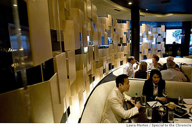Howard Cheng and Lada Eng dine in the circular shaped dining room at 5A5 Steak Lounge in San Francisco, Calif., on Tuesday, June 30, 2009. Photo: Laura Morton, Special To The Chronicle
