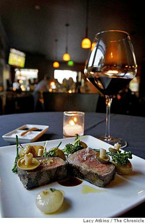 The New York steak is a favorite among the customers at the Vinoteca Restaurant Wed. July 1, 2009, in Danville, Calif. Photo: Lacy Atkins, The Chronicle