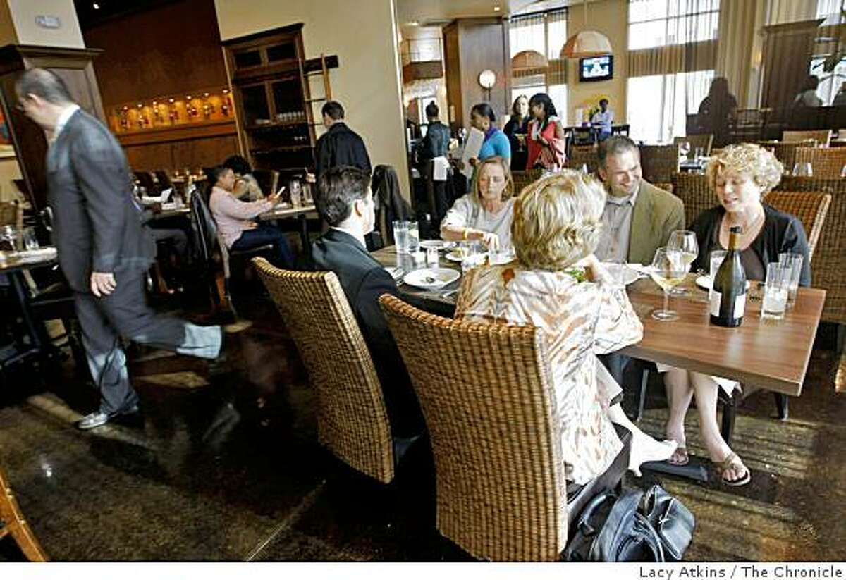 Customers enjoy dinning, Wednesday June 24, 2009, at the Pican, a new upscale southern restaurant in Oakland, Calif.