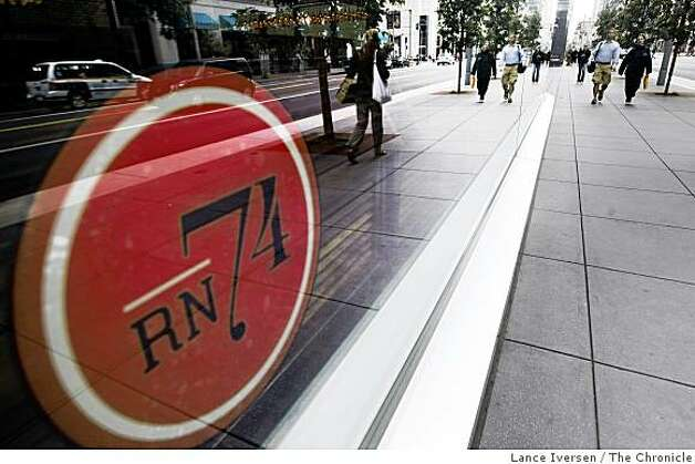Pedestrians pass in front of RN74 A new restaurant located at 301 Mission street in San Francisco offering 1,700 different wines, 50 by the glass. June 16, 2009. Photo: Lance Iversen, The Chronicle