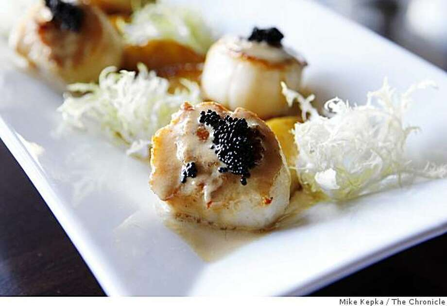 Scallops Au Deux Pommes with apples and caviar is photographed at Bijou on Tuesday May 20, 2009 in Hayward, Calif. Photo: Mike Kepka, The Chronicle