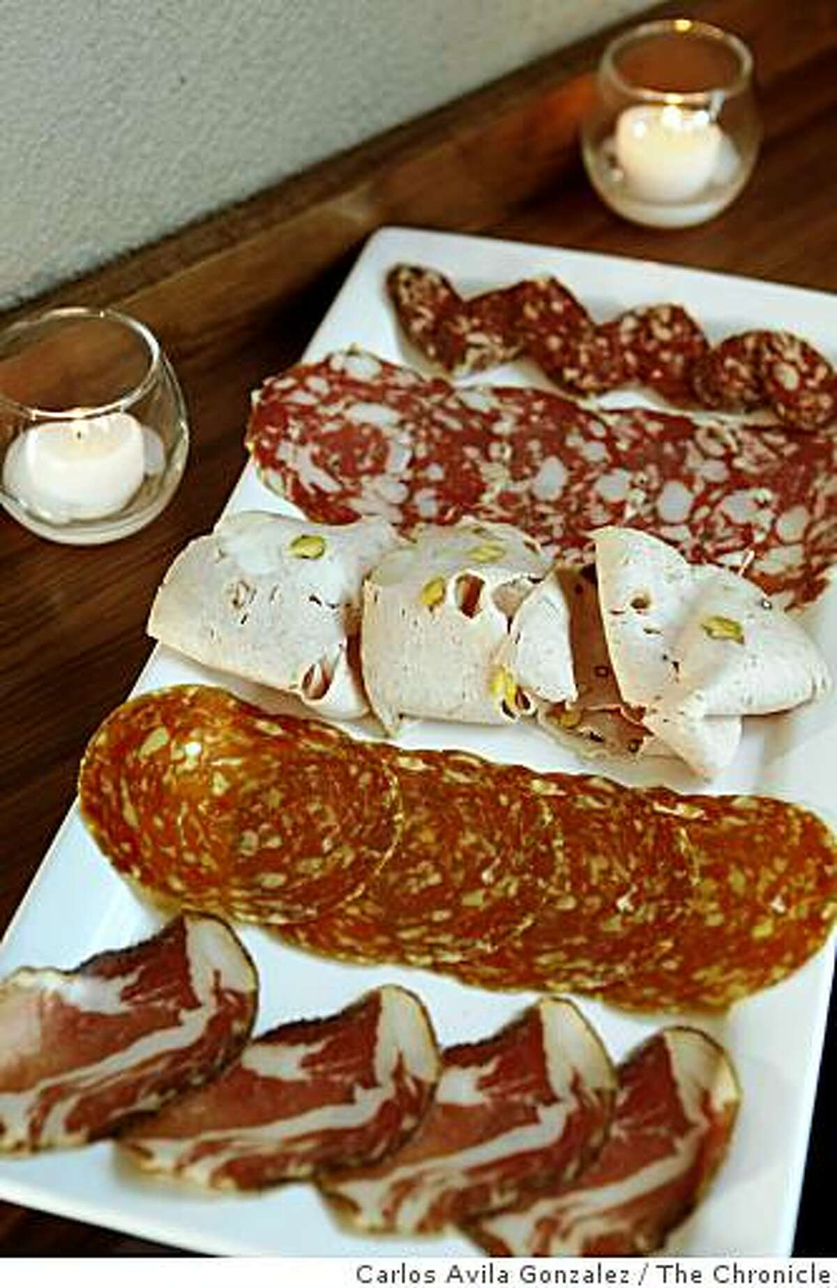 Chef's salumi platter, served at Adesso. Adesso is a new restaurant in Oakland that does exceptional salumi and pates.