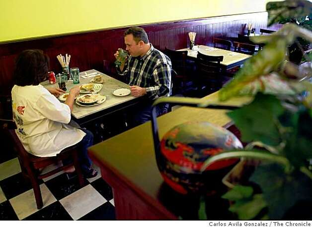 Roy Partain of Oakland, and Wilma Banatao, of Neward, enjoy lunch at Kopitiam, a Singaporean cafe in Lafayette, Calif., on Wednesday, April 22, 2009. Photo: Carlos Avila Gonzalez, The Chronicle